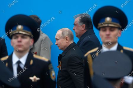 Russian President Vladimir Putin (C) and Tajik President Emomali Rahmon (C-R)  arrive to attend the Victory Day military parade in the Red Square in Moscow, Russia, 09 May 2021. The Victory Day military parade takes place annually on 09 May in the Red Square to mark the surrender of Nazi Germany in 1945.