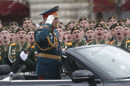 Russian Defense Minister Sergei Shoigu salutes Russian servicemen during the Victory Day military parade in the Red Square in Moscow, Russia, 09 May 2021. The Victory Day military parade takes place annually on 09 May in the Red Square to mark the surrender of Nazi Germany in 1945.