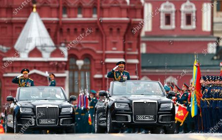 Russian Defense Minister Sergei Shoigu salutes to his soldiers as he is driven along Red Square in the Aurus Senat car during the Victory Day military parade in Moscow, Russia, marking the 76th anniversary of the end of World War II in Europe