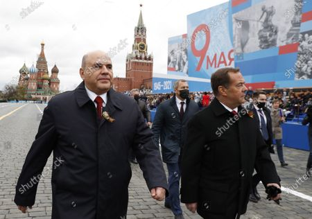 Stock Image of Russian Prime Minister Mikhail Mishustin, left, and deputy head of Russia's Security Council and the head of the United Russia party, Dmitry Medvedev, walk before the Victory Day military parade in Moscow, Russia, marking the 76th anniversary of the end of World War II in Europe