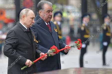 Stock Image of Russian President Vladimir Putin (L) and Tajik President Emomali Rahmon (R) lay flowers at the Memorial to Hero Cities at the Tomb of the Unknown Soldier near the Kremlin wall after the Victory Day military parade in the Red Square in Moscow, Russia, 09 May 2021. Russia holds its Victory Day parade annually on 09 May to mark the surrender of Nazi Germany in 1945.