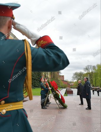 Russian President Vladimir Putin (2-R) and Tajik President Emomali Rahmon (R) take part in a wreath laying ceremony a wreath laying ceremony at the Tomb of the Unknown Soldier near the Kremlin wall after the Victory Day military parade in the Red Square in Moscow, Russia, 09 May 2021. Russia holds its Victory Day parade annually on 09 May to mark the surrender of Nazi Germany in 1945.