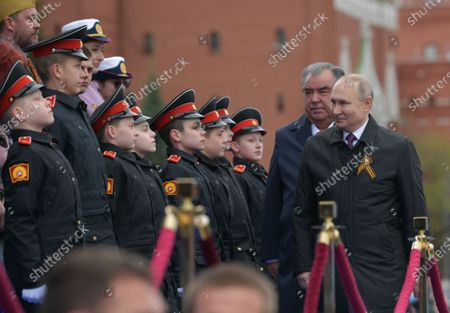 Russian President Vladimir Putin (R) and Tajik President Emomali Rahmon (2-R) arrive to attend the Victory Day military parade in the Red Square in Moscow, Russia, 09 May 2021. Russia holds its Victory Day parade annually on 09 May to mark the surrender of Nazi Germany in 1945.