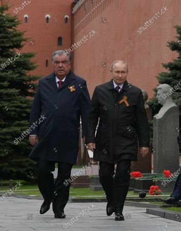 Russian President Vladimir Putin (R) and Tajik President Emomali Rahmon (L) arrive to attend the Victory Day military parade in the Red Square in Moscow, Russia, 09 May 2021. Russia holds its Victory Day parade annually on 09 May to mark the surrender of Nazi Germany in 1945.