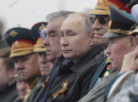 Russian President Vladimir Putin (C-R) and Tajik President Emomali Rahmon (C-L) watch the Victory Day military parade in the Red Square in Moscow, Russia, 09 May 2021. Russia holds its Victory Day parade annually on 09 May to mark the surrender of Nazi Germany in 1945.