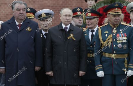 (Front L-R) Tajik President Emomali Rahmon, Russian President Vladimir Putin and Russian Defense Minister Sergei Shoigu attend a wreath laying ceremony at the Tomb of the Unknown Soldier near the Kremlin wall after the Victory Day military parade in Moscow, Russia, 09 May 2021. Russia holds its Victory Day parade annually on 09 May to mark the surrender of Nazi Germany in 1945.