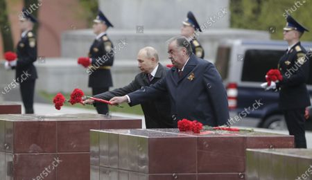 Tajik President Emomali Rahmon (R) and Russian President Vladimir Putin (L) lay flowers at the Memorial to Hero Cities at the Tomb of the Unknown Soldier near the Kremlin wall after the Victory Day military parade in Moscow, Russia, 09 May 2021. Russia holds its Victory Day parade annually on 09 May to mark the surrender of Nazi Germany in 1945.