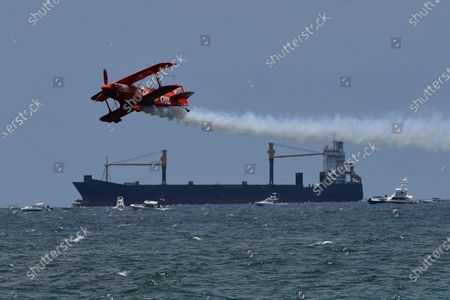 Michael Wiskus pilots the Lucas Oil Super Stinker S-1-11B during The Fort Lauderdale Air Show at Fort Lauderdale Beach, Fort Lauderdale, Florida, USA - 08 May 2021