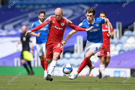 David Morgan of Accrington Stanley (l) and John Marquis of Portsmouth vie for the ball during Portsmouth vs Accrington Stanley, Sky Bet EFL League 1 Football at Fratton Park on 9th May 2021