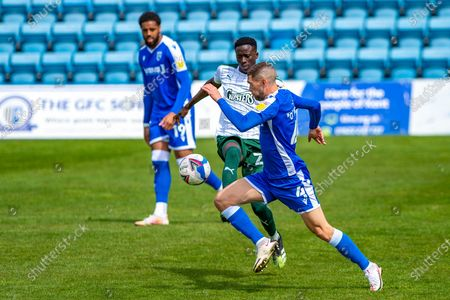 Stock Picture of Gillingham FC midfielder Stuart O'Keefe (4) and Plymouth Argyle midfielder Panutche Camara (28) during the EFL Sky Bet League 1 match between Gillingham and Plymouth Argyle at the MEMS Priestfield Stadium, Gillingham