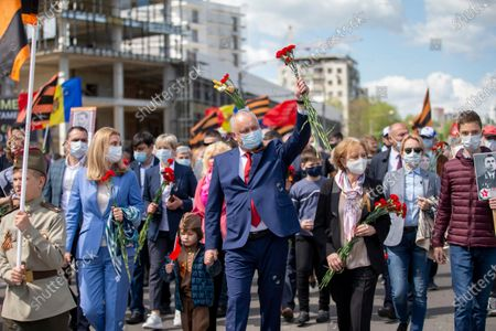 The leader of Socialist Party, former President of Moldova Igor Dodon (C) with family, salutes his supporters at the Eternity Memorial Complex during celebrations to mark the 76th anniversary of Victory Day in Chisinau, Moldova, 09 May 2021. Former Soviet Republics on 09 May celebrate the victory over Nazi Germany in WWII.