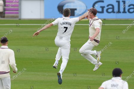 Wicket. 177 - 7. Craig Overton leaps in the air after Steve Davies had caught James Vince for 42 during the match between Hampshire County Cricket Club and Somerset County Cricket Club at the Ageas Bowl, Southampton