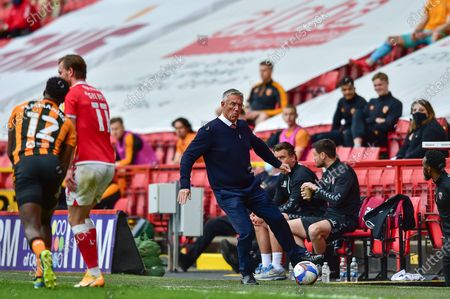 Charlton Athletic manager Nigel Adkins kicks/catches the ball during the EFL Sky Bet League 1 match between Charlton Athletic and Hull City at The Valley, London