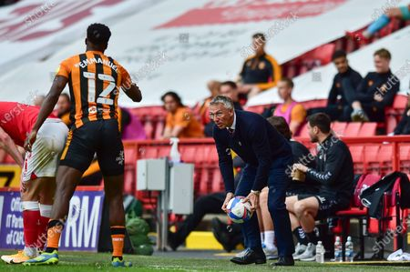 Charlton Athletic manager Nigel Adkins picks up the ball during the EFL Sky Bet League 1 match between Charlton Athletic and Hull City at The Valley, London