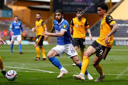 Stock Picture of Brighton's Alireza Jahanbakhsh is challenged by Wolverhampton Wanderers' Ki-Jana Hoever, right, during the English Premier League soccer match between Wolverhampton Wanderers and Brighton & Hove Albion at the Molineux Stadium in Wolverhampton, England