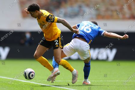 Wolverhampton Wanderers' Ki-Jana Hoever, left, fights for the ball with Brighton's Alireza Jahanbakhsh during the English Premier League soccer match between Wolverhampton Wanderers and Brighton & Hove Albion at the Molineux Stadium in Wolverhampton, England