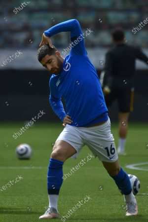 Brighton's Alireza Jahanbakhsh warms up ahead of the English Premier League soccer match between Wolverhampton Wanderers and Brighton & Hove Albion at the Molineux Stadium in Wolverhampton, England