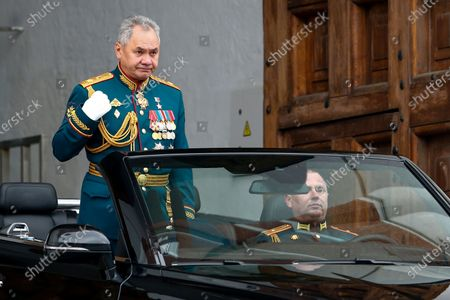 Russian Defense Minister Sergei Shoigu crosses himself was he drives to attend the Victory Day military parade in Red Square in Moscow, Russia, marking the 76th anniversary of the end of World War II in Europe. Russian President Vladimir Putin marked the anniversary of the end of World War II in Europe with a speech warning that Nazi beliefs remain strong