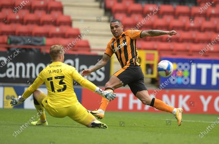 Josh Magennis of Hull City beats Ben Amos of Charlton Athletic but the shot goes wide during the Charlton Athletic vs Hull City EFL League 1 fixture at the Valley London held behind closed doors.