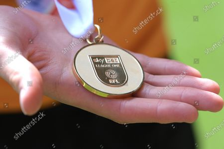 James Scott of Hull City with his League 1 winners medal after the Charlton Athletic vs Hull City EFL League 1 fixture at the Valley London held behind closed doors.