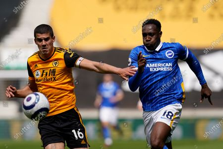 Conor Coady (L) of Wolverhampton Wanderers and Alireza Jahanbakhsh (R) of Brighton & Hove Albion in action during the English Premier League soccer match between Wolverhampton Wanderers and Brighton Hove Albion in Wolverhampton, Britain, 09 May 2021.