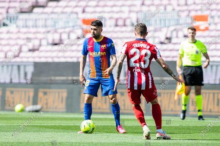 Jordi Alba of FC Barcelona and Kieran Trippier of Atletico de Madrid