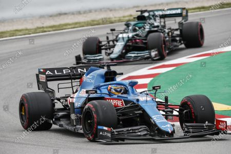 14 Fernando Alonso (spa), Alpine F1 A521, action 18 Lance Stroll (can), Aston Martin F1 AMR21, action