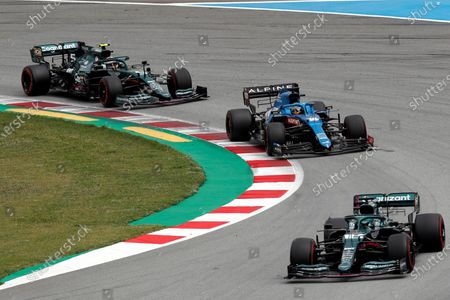 Spanish driver Fernando Alonso (C) of Alpine F1 in action next to Canadian Lance Stroll (R) of Aston Martin and German Sebastian Vettel (L) of Aston Martin during the Spanish Formula One Grand Prix at Montmelo racetrack in Barcelona, Spain, 09 May 2021.