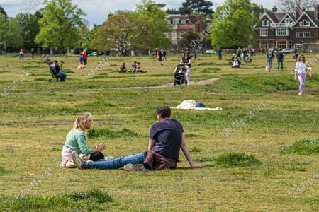 People enjoying the fine weather in Wimbledon Common, South West London  on Sunday as lockdown restrictions are lifted as weather forecasters predict warmer weather with temperatures rising over 20c on Sunday