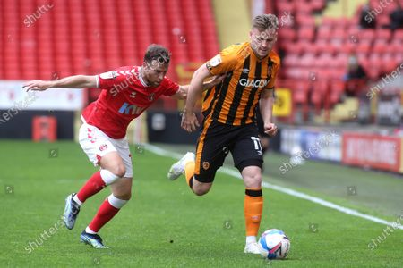 Stock Photo of James Scott of Hull City in action as Charlton's Adam Matthews looks on during Charlton Athletic vs Hull City, Sky Bet EFL League 1 Football at The Valley on 9th May 2021