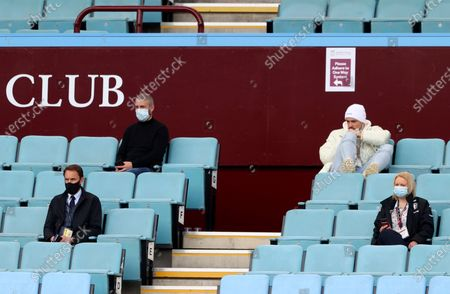 Aston Villa's Jack Grealish, top right, and England Manager Gareth Southgate, down left, watch the English Premier League soccer match between Aston Villa and Manchester United at Villa Park in Birmingham, England