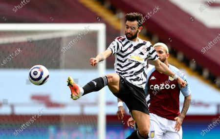 Stock Picture of Manchester United's Bruno Fernandes, front, duels for the ball with Aston Villa's Douglas Luiz during the English Premier League soccer match between Aston Villa and Manchester United at Villa Park in Birmingham, England