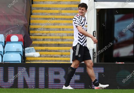 Stock Photo of Manchester United's Harry Maguire leaves the field during the English Premier League soccer match between Aston Villa and Manchester United at Villa Park in Birmingham, England