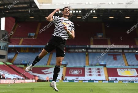 Manchester United's Edinson Cavani celebrates after scoring his side's third goal during the English Premier League soccer match between Aston Villa and Manchester United at Villa Park in Birmingham, England