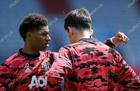 Stock Image of Manchester United's Marcus Rashford, left, speaks with Manchester United's Harry Maguire during warm up before the English Premier League soccer match between Aston Villa and Manchester United at Villa Park in Birmingham, England