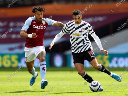 Manchester United's Mason Greenwood, right, duels for the ball with Aston Villa's Tyrone Mings during the English Premier League soccer match between Aston Villa and Manchester United at Villa Park in Birmingham, England