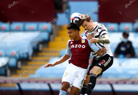 Aston Villa's Ollie Watkins, left, jumps for the ball with Manchester United's Victor Lindelof during the English Premier League soccer match between Aston Villa and Manchester United at Villa Park in Birmingham, England