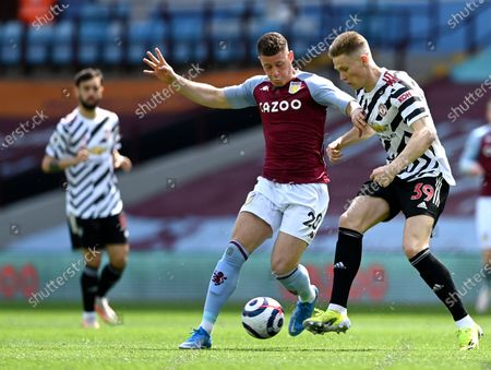 Stock Image of Manchester United's Scott McTominay, right, duels for the ball with Aston Villa's Ross Barkley during the English Premier League soccer match between Aston Villa and Manchester United at Villa Park in Birmingham, England