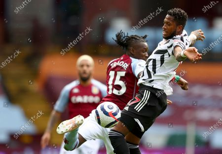 Manchester United's Fred, right, duels for the ball with Aston Villa's Bertrand Traore during the English Premier League soccer match between Aston Villa and Manchester United at Villa Park in Birmingham, England