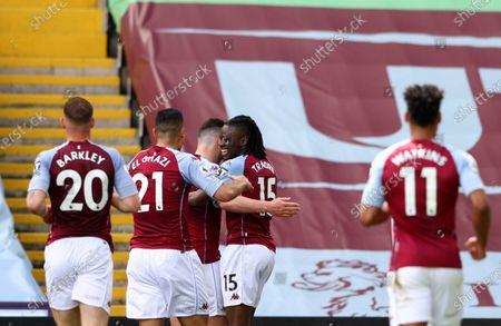 Aston Villa's Bertrand Traore, second right, celebrates with teammates after scoring his side's opening goal during the English Premier League soccer match between Aston Villa and Manchester United at Villa Park in Birmingham, England