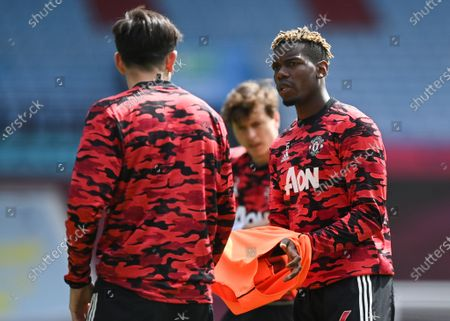 Paul Pogba (R) of Manchester United talks with his teammate Harry Maguire (L) prior to the English Premier League soccer match between Aston Villa and Manchester United in Birmingham, Britain, 09 May 2021.
