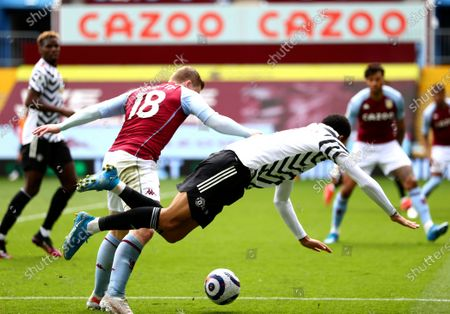 Stock Photo of Matt Targett (2-L) of Aston Villa in action against Mason Greenwood (C) of Manchester United during the English Premier League soccer match between Aston Villa and Manchester United in Birmingham, Britain, 09 May 2021.