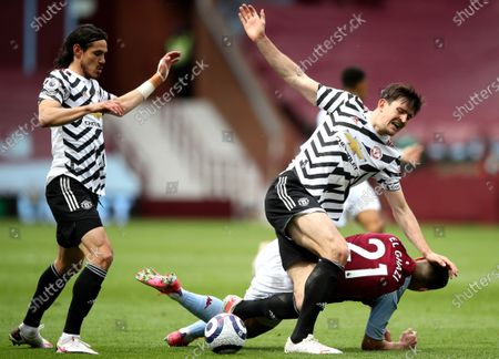 Harry Maguire (2-R) of Manchester United in action against Anwar El Ghazi (R) of Aston Villa during the English Premier League soccer match between Aston Villa and Manchester United in Birmingham, Britain, 09 May 2021.