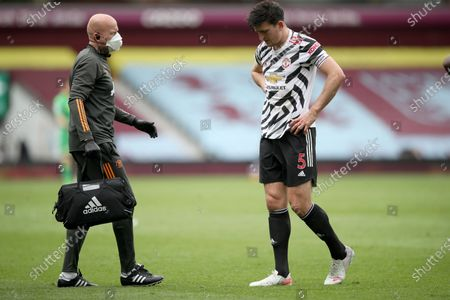 Harry Maguire (R) of Manchester United leaves the game during the English Premier League soccer match between Aston Villa and Manchester United in Birmingham, Britain, 09 May 2021.