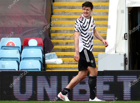 Harry Maguire of Manchester United leaves the game after sustaining an injury during the English Premier League soccer match between Aston Villa and Manchester United in Birmingham, Britain, 09 May 2021.