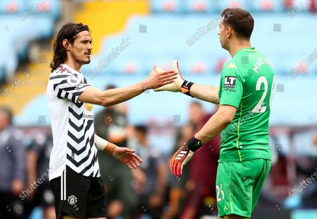 Edinson Cavani (L) of Manchester United greets goalkepeer Emiliano Martinez (R) of Aston Villa after the English Premier League soccer match between Aston Villa and Manchester United in Birmingham, Britain, 09 May 2021.