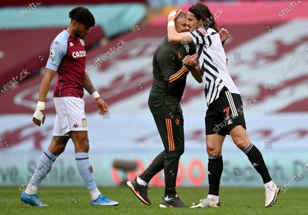 Edinson Cavani (R) of Manchester United hugs his manager Ole Gunnar Solskjer (C) after the English Premier League soccer match between Aston Villa and Manchester United in Birmingham, Britain, 09 May 2021.