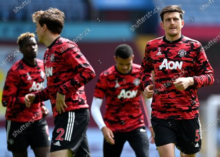 Harry Maguire (R) and teammates of Manchester United warm up prior to the English Premier League soccer match between Aston Villa and Manchester United in Birmingham, Britain, 09 May 2021.