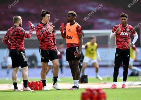 Paul Pogba (C) of Manchester United talks with his teammate Harry Maguire (2-L) prior to the English Premier League soccer match between Aston Villa and Manchester United in Birmingham, Britain, 09 May 2021.