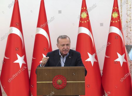 Turkey's President Recep Tayyip Erdogan speaks during an event in Ankara, Turkey, . In a speech after the breaking of Ramadan fast late Saturday, Erdogan, has strongly condemned violence in Jerusalem. On Friday, more than 200 Palestinians were wounded in clashes at the Al-Aqsa Mosque compound and elsewhere in Jerusalem, drawing condemnations from Israel's Arab allies and calls for calm from the United States, Europe and the United Nations